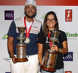 Marcos Negrini e Lauren Grinberg com os trofeus de campeoes do Abeto do Estado de SP 328