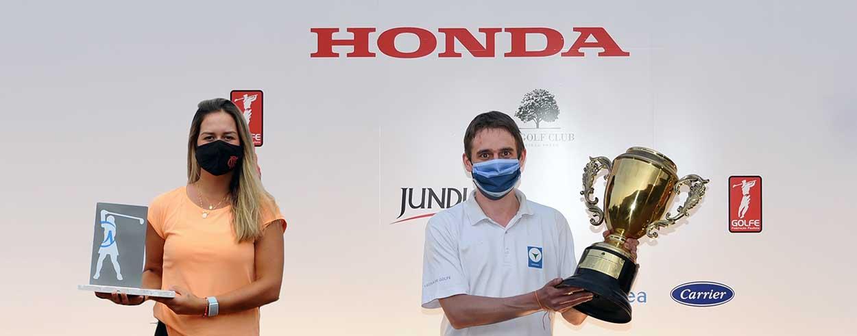 Pedro Costa Lima e Lauren Grinberg com trofeus 1250